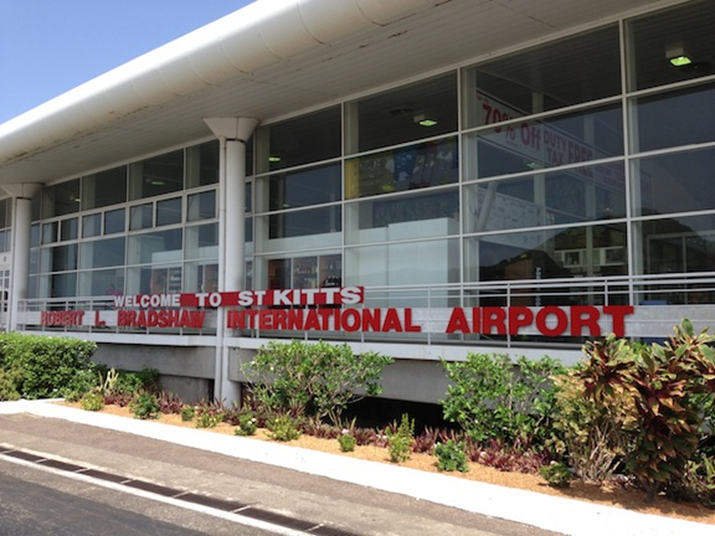 Huggins on the job at St kitts' Bradshaw Airport; Minister Brantley looking into Allegations of Security Breach